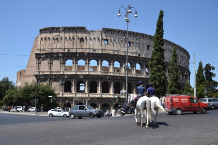 Rome, Italy - July 10, 2012  Police patrol on horses in front of Colosseum in Rome  Police patrol on horses crosses the street in front of Colosseum in Rome, Italy  Stock Photo - 15838959