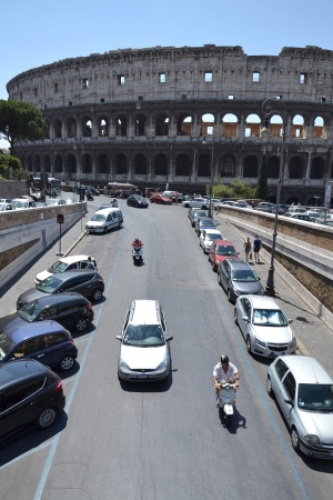 Rome, Italy - July 10, 2012  Cars in front of Colosseum in Rome  Experts say ancient building has started to tilt and may need urgent repairs  Stock Photo - 15838958