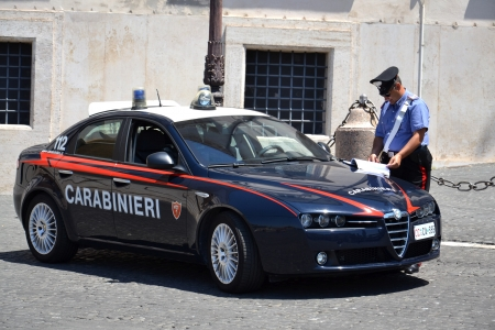 arma: Rome, Italy - July 10, 2012: Italian carabinier with car in front of the Quirinal Palace - home to the Italian president, on 10 July 2012 in Rome, Italy. Carabinieri  The Arma Carabinieri is one of the four armed forces of Italy.