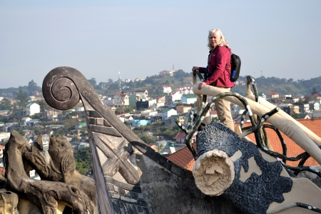 Dalat, Vietnam - February 10, 2012: Woman at the top of the Crazy house in Dalat, Vietnam. Chinese People