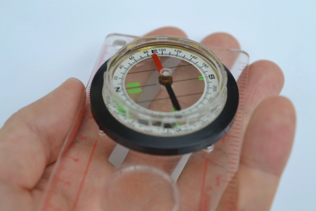 Detail shot of a glass compass on white background Stock Photo - 16750407