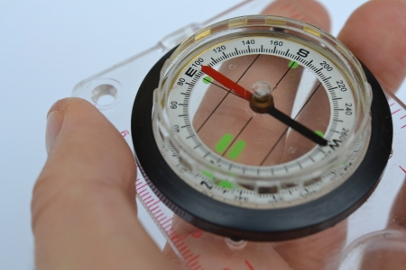 Detail shot of a glass compass on white background Stock Photo - 16750418