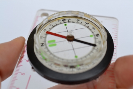 Detail shot of a glass compass on white background Stock Photo - 16750414