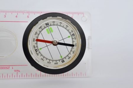 Detail shot of a glass compass on white background Stock Photo - 16750399