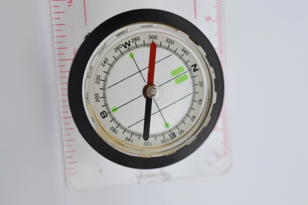 Detail shot of a glass compass on white background Stock Photo - 16750394