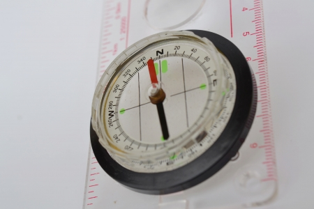 Detail shot of a glass compass on white background Stock Photo - 16750390