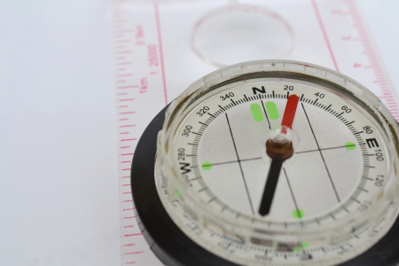 Detail shot of a glass compass on white background Stock Photo - 16750400
