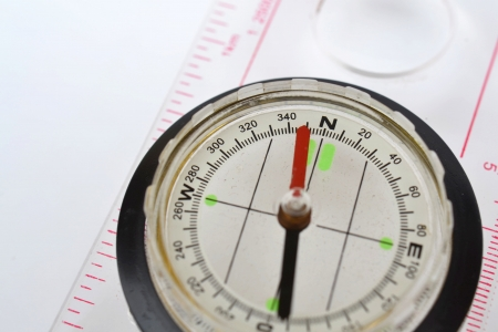 Detail shot of a glass compass on white background Stock Photo - 16750417