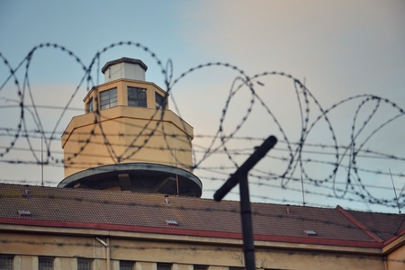 Barbed wire around prison walls photo