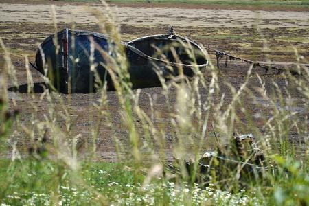 Wrecked boat in Fort William, Scotland, United Kingdom photo