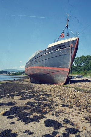 Filtered picture of an abandoned shipwreck in Fort William, Scotland, United Kingdom photo