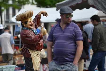 Brussels, Belgium - July 14, 2014: People shopping on a daily flea market at Place du Jeu de Balle on July 14, 2014 in Brussels, Belgium. Editorial