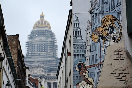 BRUSSELS, BELGIUM - JULY 11: Filtered picture of a comic strip mural painting on July 11, 2014 in Brussels, Belgium. Brussels is known as a homeland of the comic strips and is full of images of numerous comic strip heroes. Редакционное
