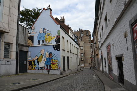 Brussels, Belgium - July 14, 2014: Filtered picture of a comic strip mural painting on July 14, 2014 in Brussels, Belgium. Brussels is known as a homeland of the comic strips and is full of images of numerous comic strip heroes. 報道画像