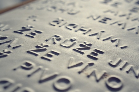 blind people: Embossed writing for blind people in Czech used before Braille writing system Stock Photo
