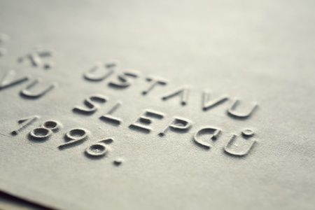 sightless: Embossed writing for blind people in Czech used before Braille writing system Stock Photo