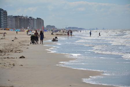 OOSTENDE, BELGIUM - JULY 14: People walk on a seafront promenade on July 14, 2014 in Oostende, Belgium.