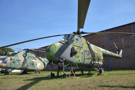 Old military helicopter stands on an airport