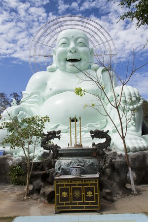 smiling buddha: Statue of sitting and smiling Buddha in Vietnam Stock Photo