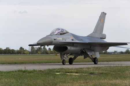 interceptor: HRADEC KRALOVE, CZECH REPUBLIC - SEPTEMBER 5: Landing F-16 Fighting Falcon with Belgian flag on the CIAF – Czech international air fest on September 5, 2015 in Hradec Kralove, Czech republic. Editorial