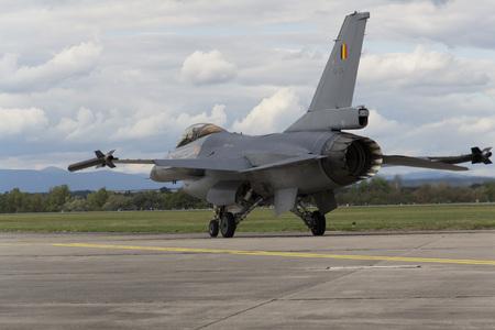 HRADEC KRALOVE, CZECH REPUBLIC - SEPTEMBER 5: Landing F-16 Fighting Falcon with Belgian flag on the CIAF – Czech international air fest on September 5, 2015 in Hradec Kralove, Czech republic. Editorial
