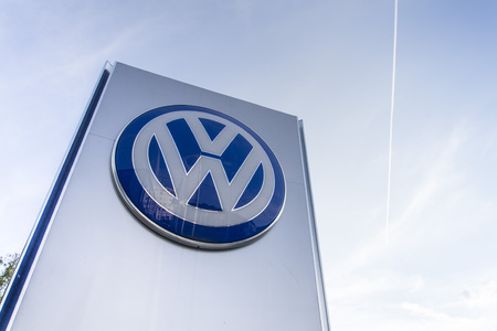 scandal: PRAGUE, CZECH REPUBLIC - SEPTEMBER 5: Volkswagen carmaker logo on a building of dealership on September 24, 2015 in Prague, Czech republic. Great emission scandal raises around number of Volkswagen Group cars with the EA189, 2.0 litre TDI engine.