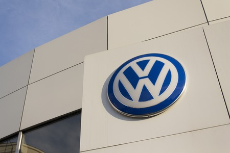 litre: PRAGUE, CZECH REPUBLIC - SEPTEMBER 5: Volkswagen carmaker logo on a building of dealership on September 24, 2015 in Prague, Czech republic. Great emission scandal raises around number of Volkswagen Group cars with the EA189, 2.0 litre TDI engine.