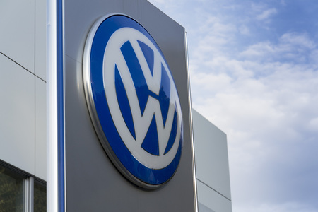 logo marketing: PRAGUE, CZECH REPUBLIC - SEPTEMBER 5: Volkswagen carmaker logo on a building of dealership on September 24, 2015 in Prague, Czech republic. Great emission scandal raises around number of Volkswagen Group cars with the EA189, 2.0 litre TDI engine.