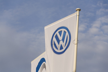 20   24: PRAGUE, CZECH REPUBLIC - SEPTEMBER 5: Volkswagen carmaker logo on a building of dealership on September 24, 2015 in Prague, Czech republic. Great emission scandal raises around number of Volkswagen Group cars with the EA189, 2.0 litre TDI engine.
