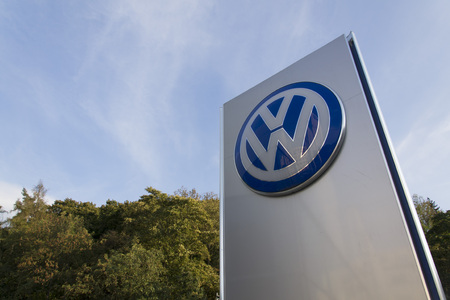 PRAGUE, CZECH REPUBLIC - SEPTEMBER 5: Volkswagen carmaker logo on a building of dealership on September 24, 2015 in Prague, Czech republic. Great emission scandal raises around number of Volkswagen Group cars with the EA189, 2.0 litre TDI engine. Stock Photo - 45997739