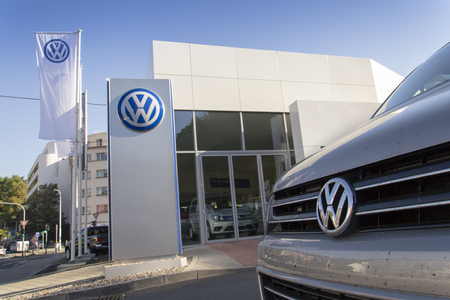 PRAGUE, CZECH REPUBLIC - OCTOBER 1: Car with Volkswagen logo in front of dealership building on October 1, 2015 in Prague, Czech republic.