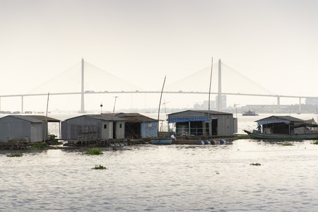 ratty: Ratty boats and raft houses with fish cages floating on Mekong river on a cloudy day in My To, Vietnam