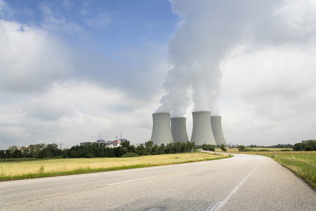 temelin: Cooling towers with steam vapour at the Temelin nuclear power station in Czech republic on sunny day