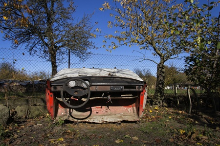weather gauge: Rusty vintage car cut in half on a sunny day in autumn garden