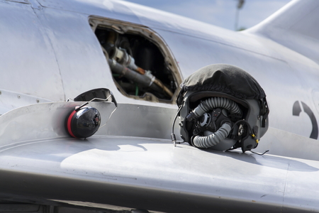 force: Detail of helmet and headphones on wing of jet fighter aircraft Mikoyan-Gurevich MiG-15 developed for the Soviet Union