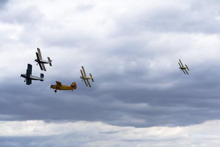 HRADEC KRALOVE, CZECH REPUBLIC - SEPTEMBER 5: Group of Antonov An-2 biplanes flying on September 5, 2015 in Hradec Kralove, Czech republic.