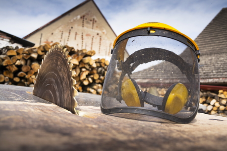 switched: Protective helmet on switched off old rusty circular saw