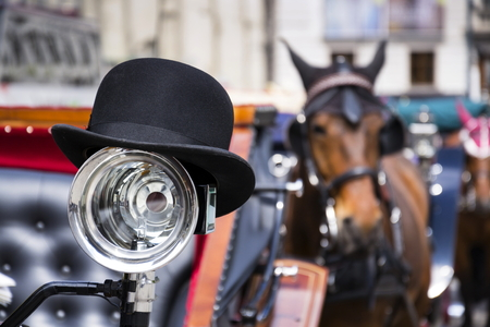 bowler: Horse carriage in Vienna, Austria with bowler on the light
