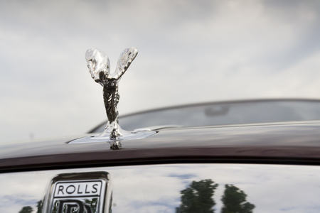 ecstasy: PRAGUE, CZECH REPUBLIC - MAY 20: Rolls-Royce Wraith coupé car with Spirit of Ecstasy emblem - the most powerful Rolls-Royce in history on May 20, 2016 in Prague, Czech republic.
