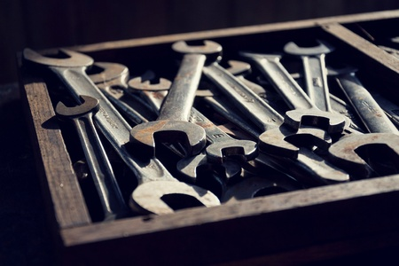 loads: Loads of wrenches or spanners in a wooden drawer Stock Photo