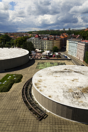 karlovy: KARLOVY VARY, CZECH REPUBLIC - JULY 3: People walk on streets of spa town Karlovy Vary with roof of Hotel Thermal in foreground on July 3, 2016 in Karlovy Vary, Czech republic. Editorial