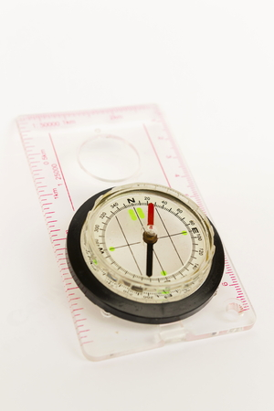 azimuth: Detail shot of a glass compass on white background