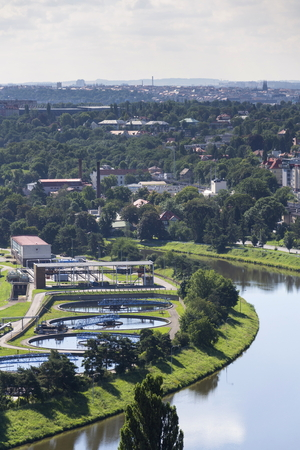 meandering: Aerial view of river meandering around sewage water treatment plant