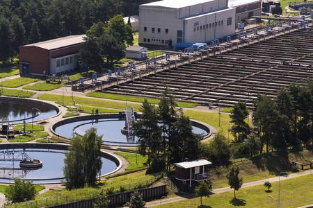 storage tanks: Men checking water storage tanks at sewage treatment plant