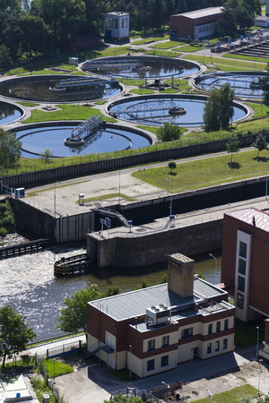 turbid: Sewage water treatment plant with river in foreground aerial view Stock Photo