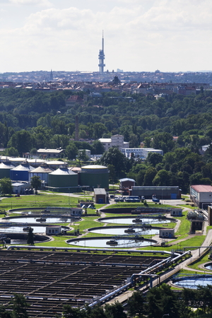 turbid: Prague sewage water treatment plant with Zizkov tower in background