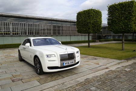 WESTHAMPNETT, UNITED KINGDOM - AUGUST 11: Rolls-Royce Ghost in front of the Goodwood plant on August 11, 2016 in Westhampnett, United Kingdom.WESTHAMPNETT, UNITED KINGDOM - AUGUST 11: Rolls-Royce Ghost in front of the Goodwood plant on August 11, 2016 in