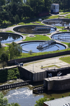 Sewage water treatment plant with river in foreground aerial view Stock Photo