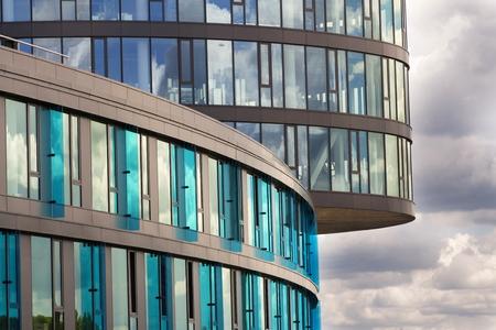 breakers: Blue brise soleil sun breakers on modern office glass building Stock Photo