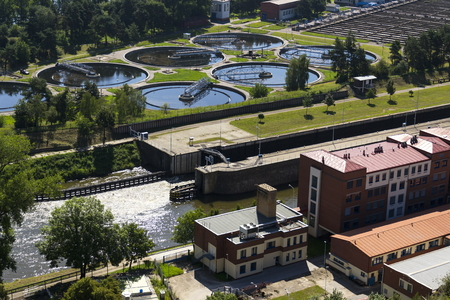 turbid: Aerial view of storage tanks in sewage water treatment plant Stock Photo